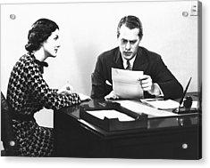 Secretary Assisting Businessman Reading Document At Desk, (b&w) Acrylic Print by George Marks
