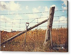 Shovels Leaning Against The Fence Acrylic Print by Sandra Cunningham