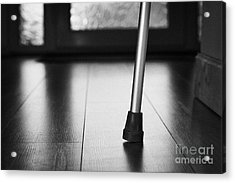 Single Crutch Leg Leaning Against A Wall In A House In The Uk Acrylic Print by Joe Fox