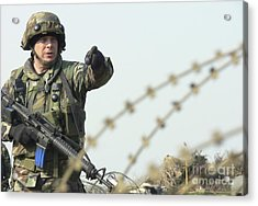 Soldier Calls Out Approaching Locals Acrylic Print by Stocktrek Images