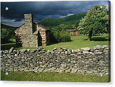Storm Clouds Form Above Log Buildings Acrylic Print by Raymond Gehman