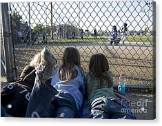 Three Girls Watching Ball Game Behind Home Plate Acrylic Print by Christopher Purcell