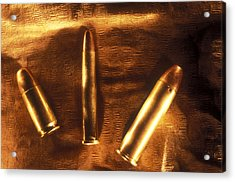 Three Golden 38 Calibre Bullets Acrylic Print by Lyle Leduc