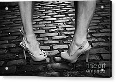 Two Young Women Wearing High Heeled Shoes And Fake Tan On Cobblestones On A Night Out Acrylic Print by Joe Fox