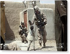 U.s. Marine Gives An Afghan Child Acrylic Print by Stocktrek Images