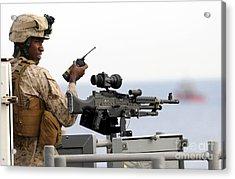 U.s. Marine Talks On A Radio While Acrylic Print by Stocktrek Images