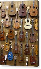 Various Guitars & Ukuleles Hanging From Wall Acrylic Print by Lisa Romerein