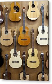 Various Guitars Hanging From Wall Acrylic Print by Lisa Romerein