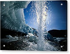 Water Splashes Over A Sheet Of Ice Acrylic Print by Raymond Gehman