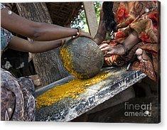 Crushing Turmeric Roots To Powder Acrylic Print by Tim Gainey