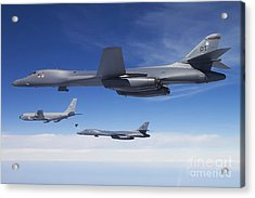 A B-1b Lancer Stands By As Another Acrylic Print by Stocktrek Images