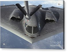A B-2 Spirit Bomber Prepares To Refuel Acrylic Print by Stocktrek Images