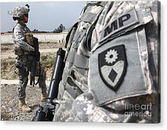 A Military Police Officer Provides Acrylic Print by Stocktrek Images