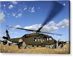 Airmen Provide Security In Front Acrylic Print by Stocktrek Images
