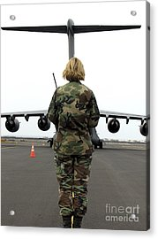 An Airfield Manager Greets An Arriving Acrylic Print by Stocktrek Images