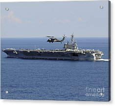 An Mh-60s Seahawk Helicopter Flies Acrylic Print by Stocktrek Images