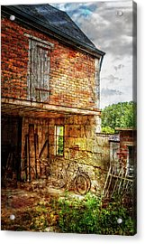 Bicycles In The Courtyard Acrylic Print by Debra and Dave Vanderlaan