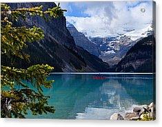 Canoe On Lake Louise Acrylic Print by Larry Ricker