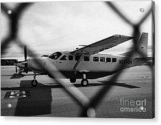 cessna 208B sightseeing tour aircraft at Grand canyon west airport Arizona USA Acrylic Print by Joe Fox