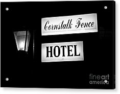 Cornstalk Fence Hotel Acrylic Print by Leslie Leda