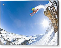 Freestyle Skier Jumping Off Cliff Acrylic Print by Tyler Stableford