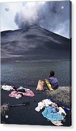 Girl Washing Clothes In A Lake With The Mount Yasur Volcano Emitting Smoke In The Background Acrylic Print by Sami Sarkis