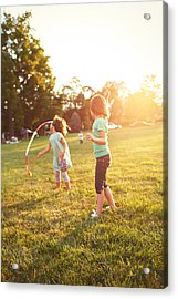 Girls Playing Together On Evening Lawn Acrylic Print by Gillham Studios