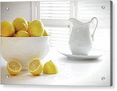 Lemons In Large Bowl On Table Acrylic Print by Sandra Cunningham