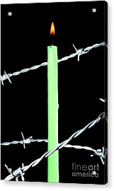 Lit Candle Surrounded By Barbed Wire Acrylic Print by Sami Sarkis