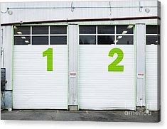 Numbers On Repair Shop Bay Doors Acrylic Print by Don Mason