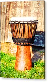 Original African Djembe Drum With Leather Lamina On Green In Sun Light. Acrylic Print by Jozef Klopacka