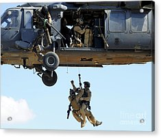 Pararescuemen Are Hoisted Into An Hh-60 Acrylic Print by Stocktrek Images