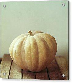 Pumpkin On Wooden Table Acrylic Print by Copyright Anna Nemoy(Xaomena)