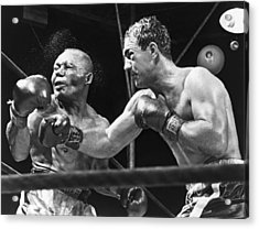 Rocky Marciano Landing A Punch Acrylic Print by Everett