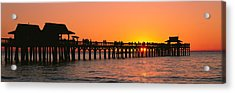 Silhouette Of Huts And A Pier At Dusk Acrylic Print by Panoramic Images