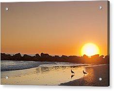 Silhouette Of Rocks On Beach At Sunset Acrylic Print by Markus Henttonen