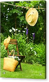 Straw Hat Hanging On Clothesline Acrylic Print by Sandra Cunningham