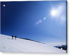 Two Hikers Explore A Snowfield Acrylic Print by Bill Hatcher