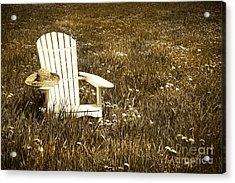 White Chair With Straw Hat In A Field Acrylic Print by Sandra Cunningham