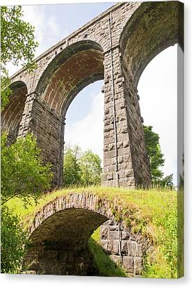 An Ancient Packhorse Bridge In Dentdale Canvas Print by Ashley Cooper