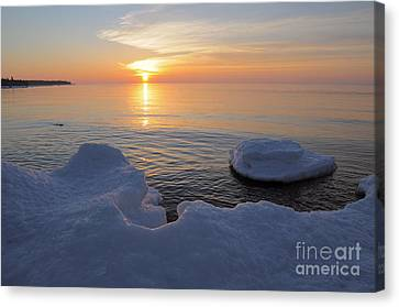 An Icy  Superior Sunrise Canvas Print by Sandra Updyke