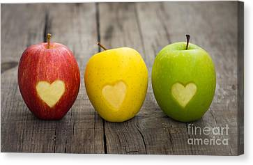 Apples With Engraved Hearts Canvas Print by Aged Pixel