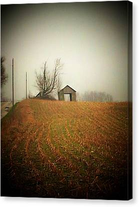 Barn And Road Canvas Print by Michael L Kimble