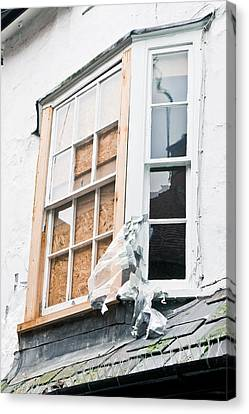 Boarded Up Window Canvas Print by Tom Gowanlock