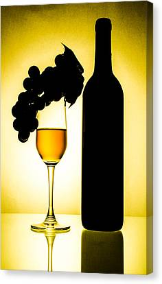 Bottle And Wine Glass Canvas Print by Sirapol Siricharattakul