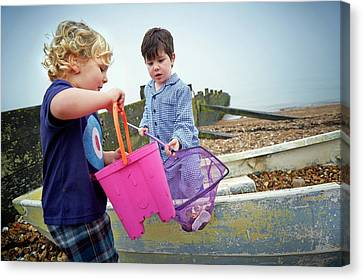 Boys Playing On Beach Canvas Print by Ruth Jenkinson