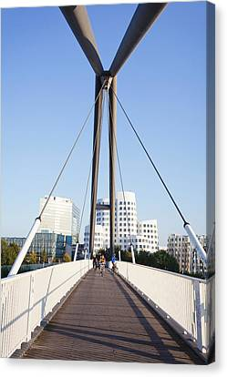 Bridge With Neuer Zollhof Buildings Canvas Print by Panoramic Images