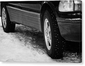 Car With Studded Winter Tyres Parked On Ice In Kirkenes Finnmark Norway Europe Canvas Print by Joe Fox
