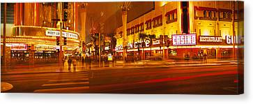 Casino Lit Up At Night, Fremont Street Canvas Print by Panoramic Images