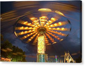 Chair Swing Fairground Ride Canvas Print by Jim West